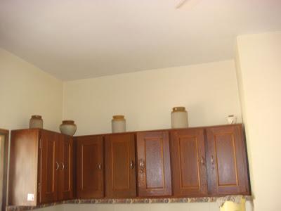 traditional Mangalorean pickle jars at kitchen cabinet
