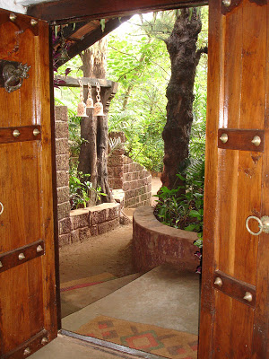 The main entrance to the house is created by the two existing casuarina trees