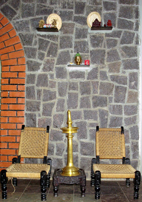 The brass artifacts and traditional furniture bring in the Indian touch