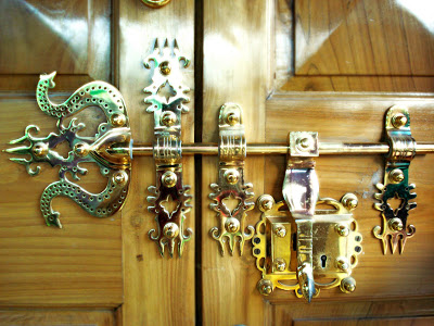 The traditional lock called manichitrathazu and hardware on the main door, handpicked from Kochi