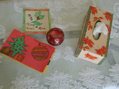 A completed poinsettia themed decoupage on a tissue box