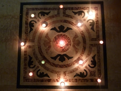 T-light holders adorning the rangoli