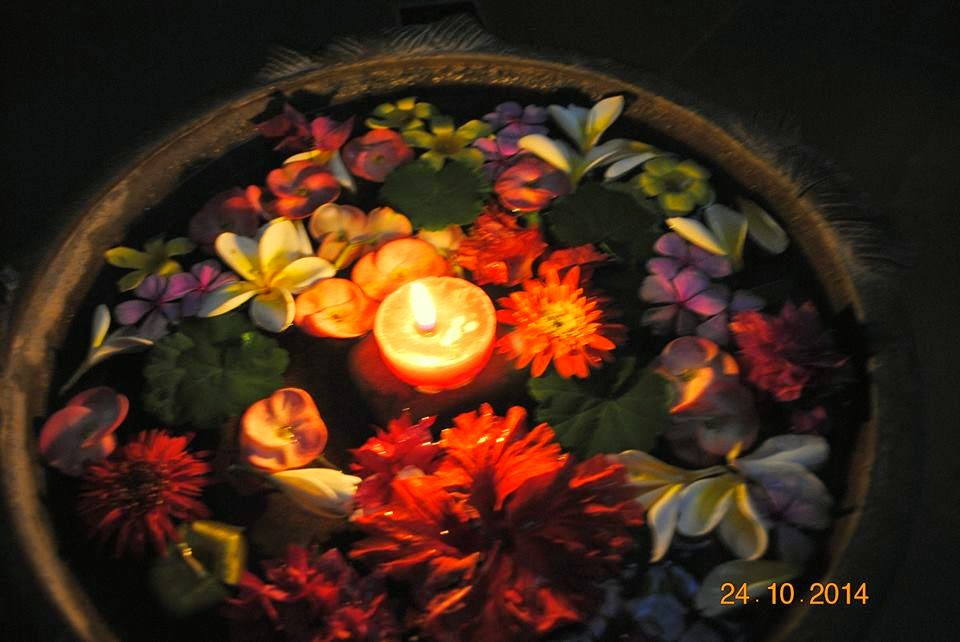 The beautiful flower rangoli on water in a bowl