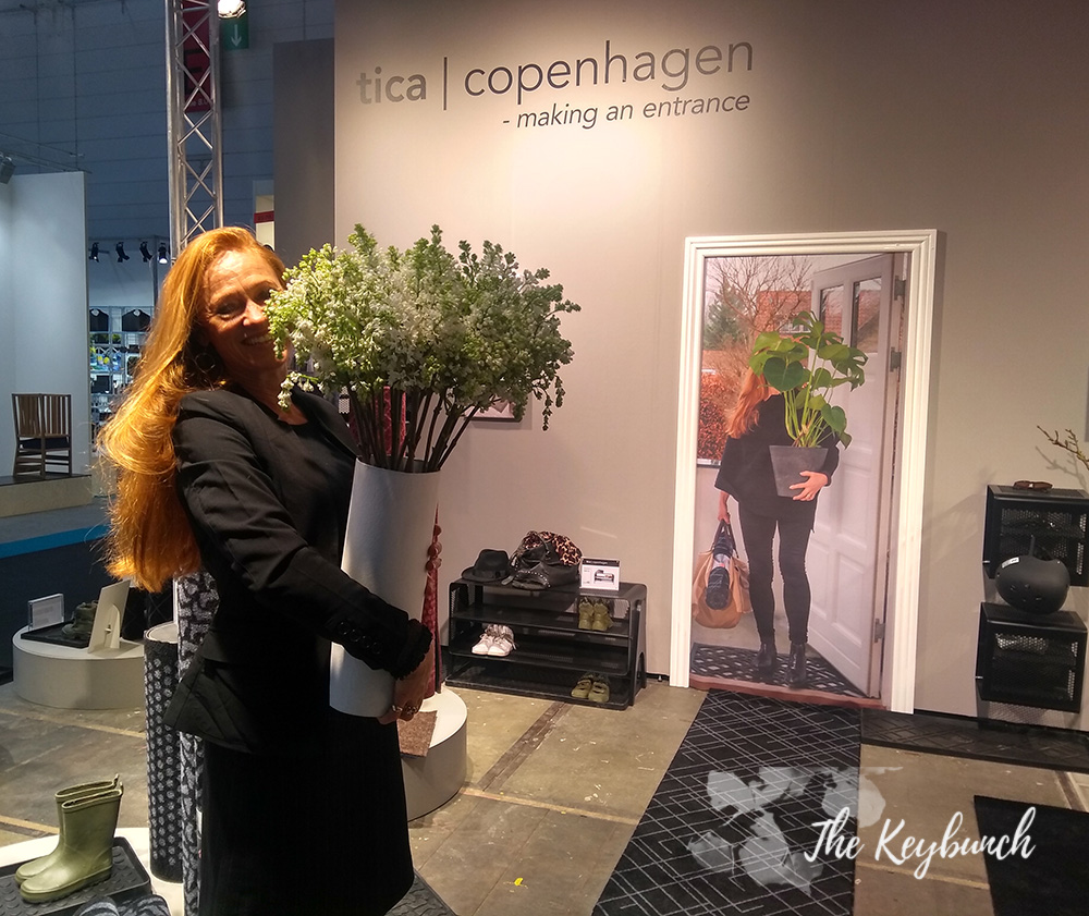 Tica Copenhagen founder of Tia Bremhholm posing with a pot, just like the one on the ad in her stall!