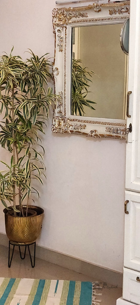 Jayashree Rajan's garden apartment tour on The Keybunch: A charming old mirror with gold embellishments