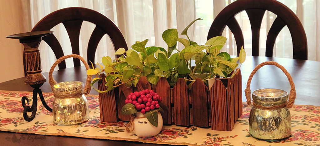 Jayashree Rajan's garden apartment tour on The Keybunch: dining table with green plants