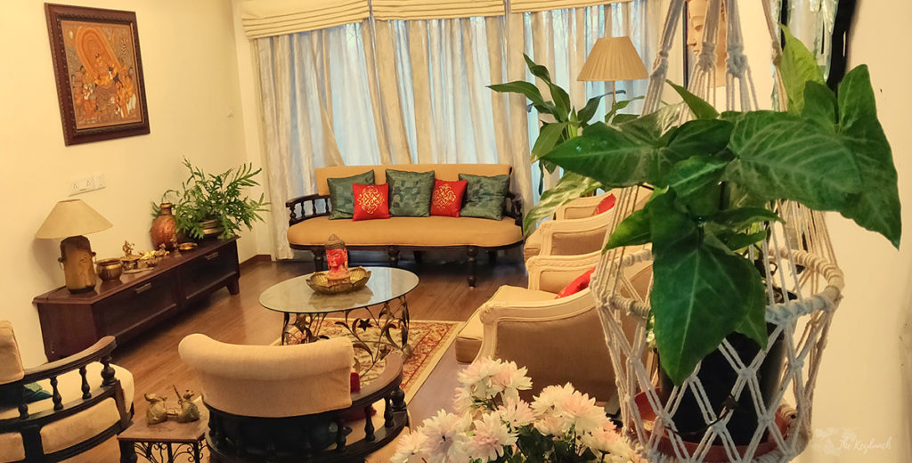 Jayashree Rajan's garden apartment tour on The Keybunch: Living room with macrame plant hanger