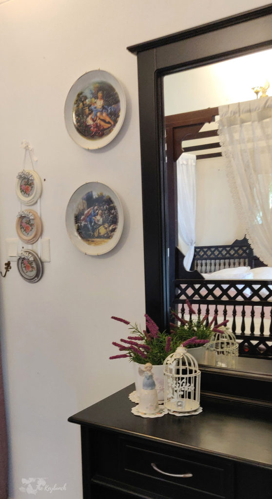 Jayashree Rajan's garden apartment tour on The Keybunch: wall plates, birdcage and cabinet