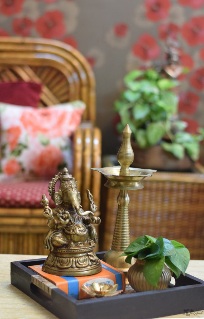 Home decor Tour by Ankita and Sitanshu's in Lucknow - brass collection and green plants at living room