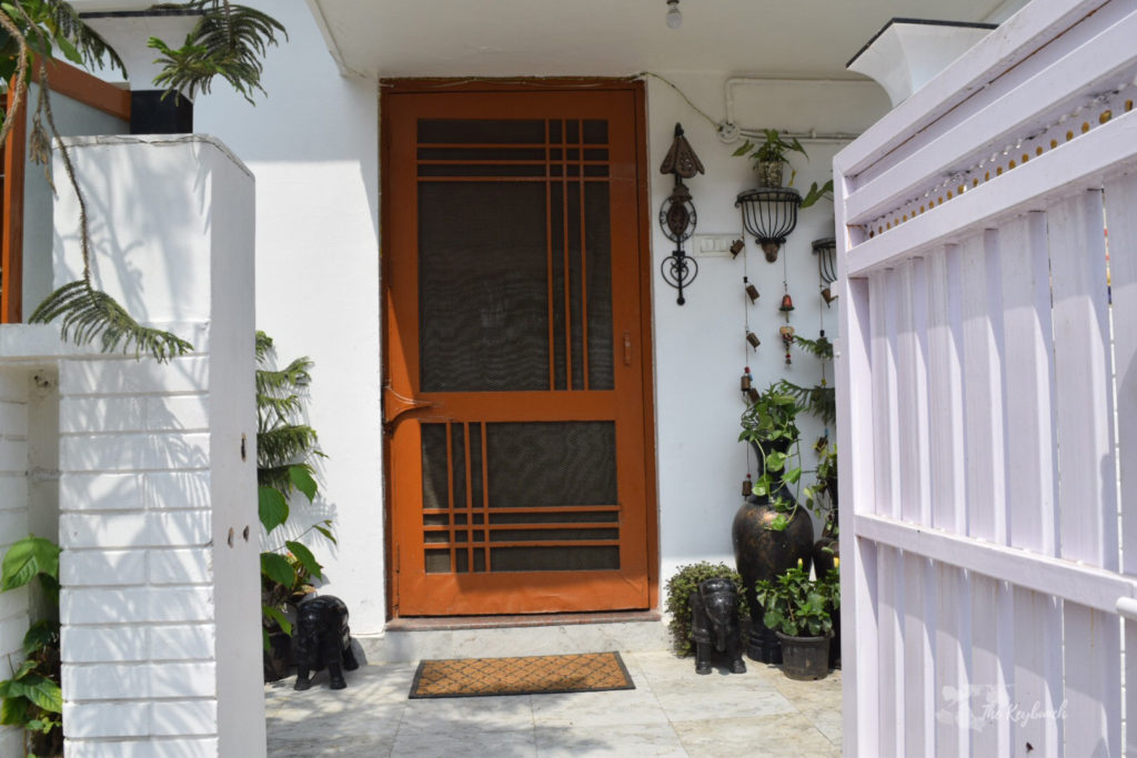 Home decor Tour by Ankita and Sitanshu's in Lucknow - Green plants at the door entrance