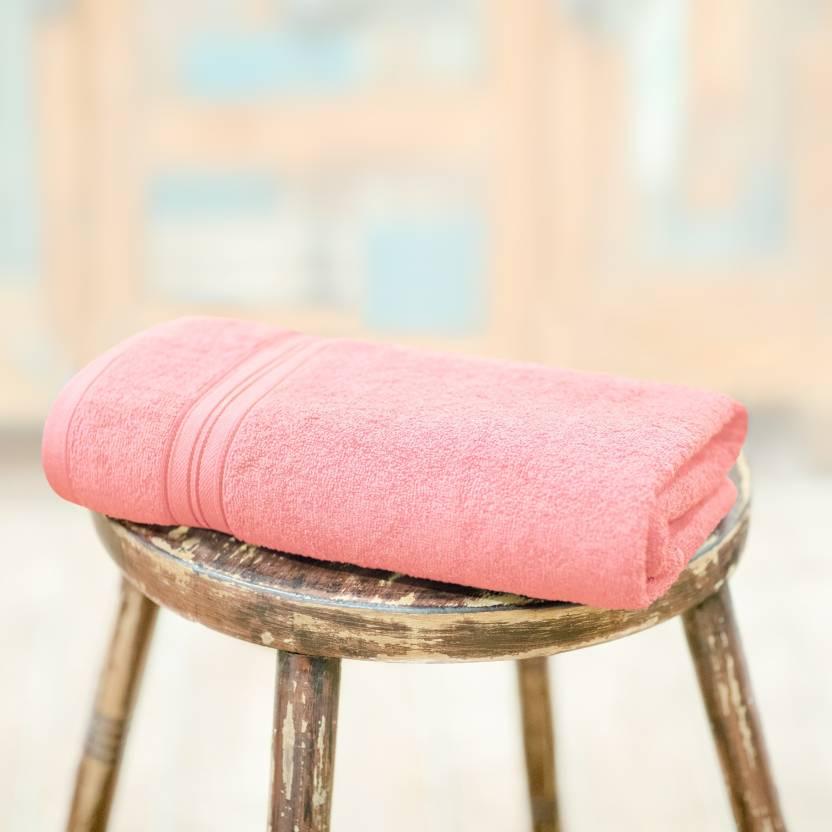 A bath towel in fresh peach color