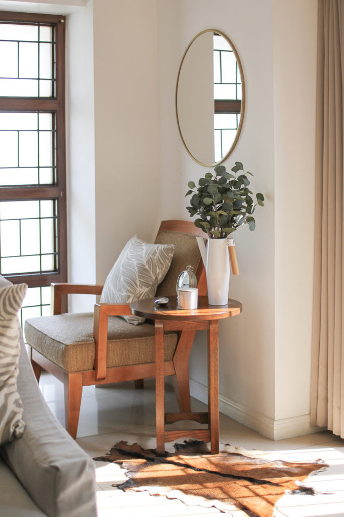 Home Tour with Kaho of Chuzai Living - the entryway room filled with green plants, chair and mirrow frame