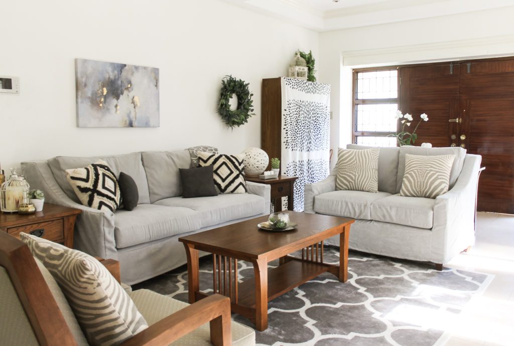 Home Tour with Kaho of Chuzai Living - the living room filled with wreath, painting frame on wall, and beautiful cushion cover