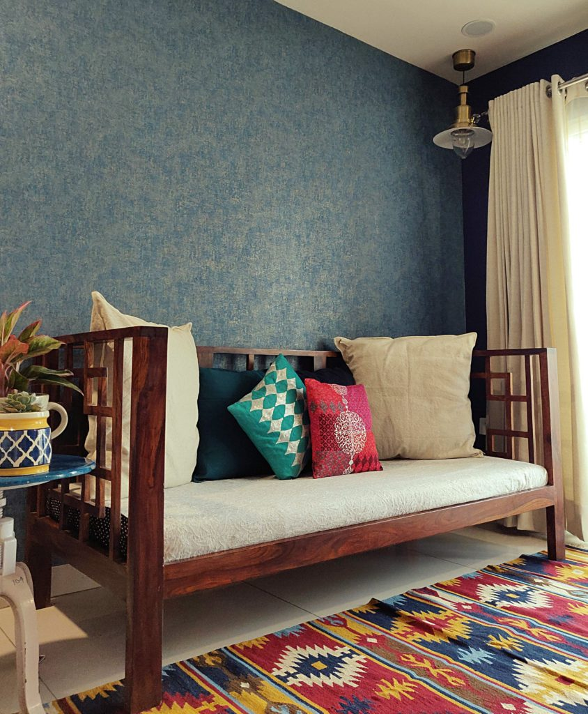 Home style Tour with Rajni in Hyderabad: the collection of colorful rug, cushion covers and plants make the living area super gorgeous