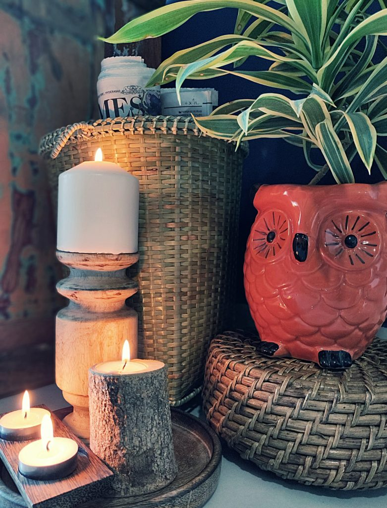 Home style Tour with Rajni in Hyderabad: the collection of owl planter, basket and candle holders makes the corner of the room so beautiful