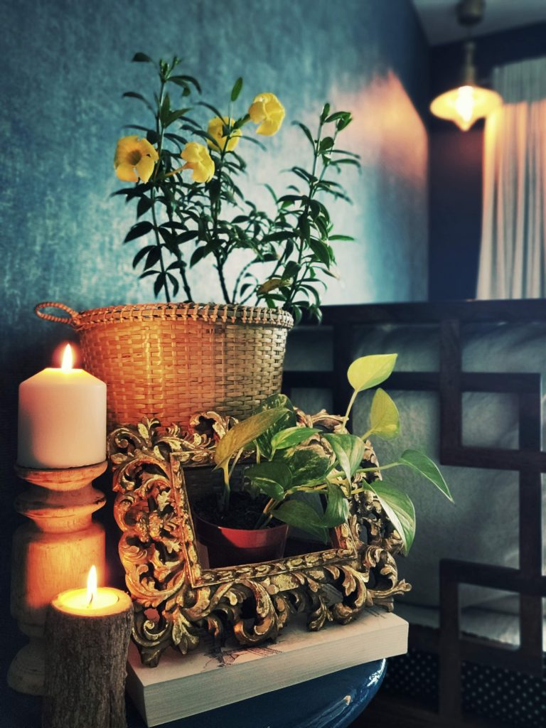 Home style Tour with Rajni in Hyderabad: the room is filled with candles, basket plant and green plants