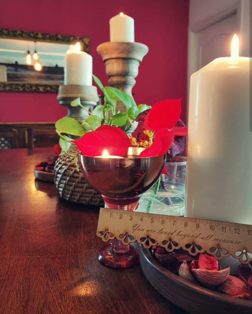 Home style Tour with Rajni in Hyderabad: the side table is decorated with some candles in nice candle holders/votives some fresh flower arrangements in vase or just petals in a copper bowl
