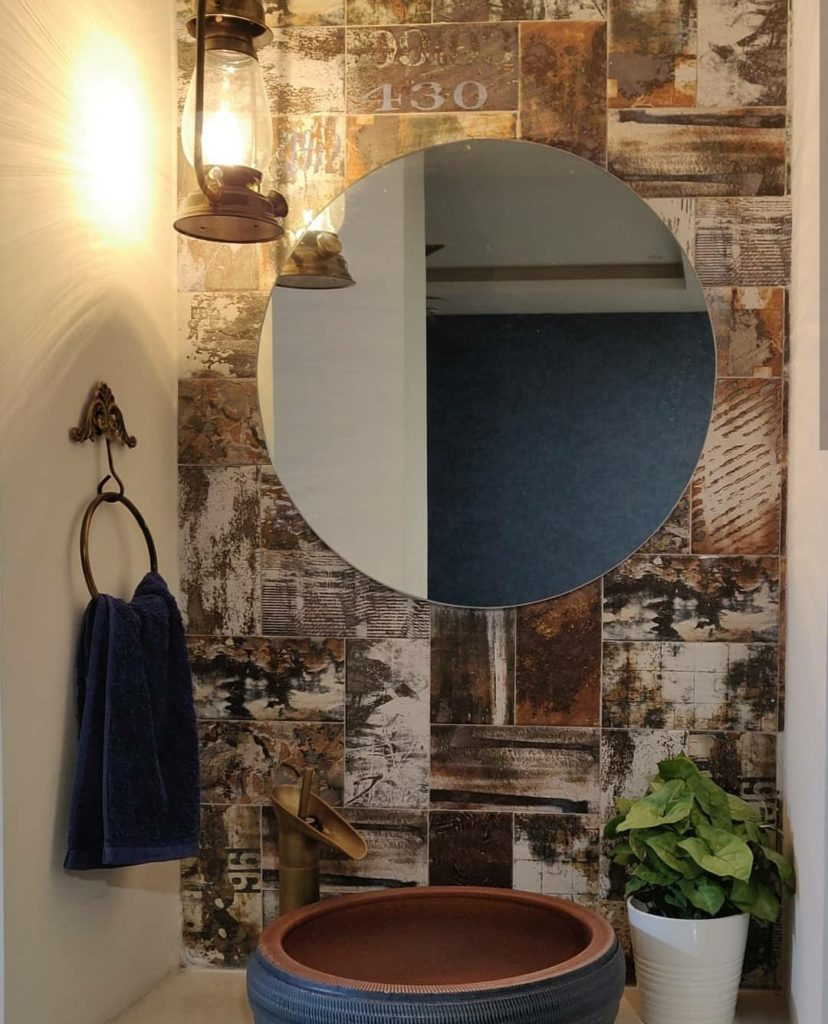 Home style Tour with Rajni in Hyderabad: the rustic tiles, the lantern, the blue sink, vintage tap, rustic towel ring and green plant makes a beautiful space