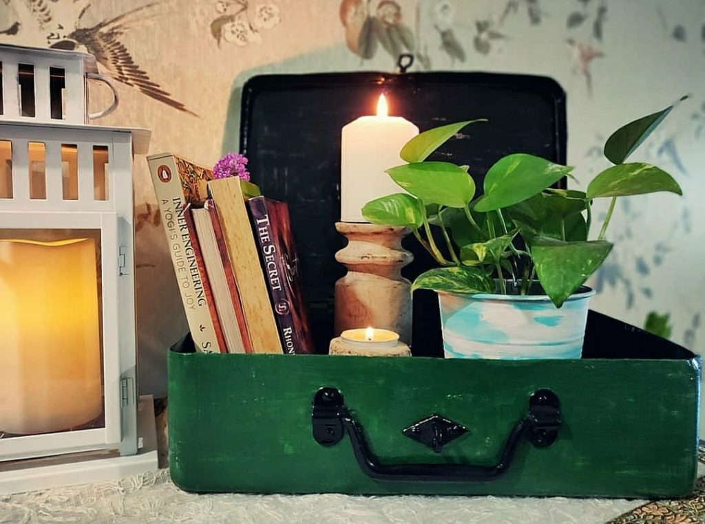 Home style Tour with Rajni in Hyderabad: The old trunk is painted and kept on entryway console to hold books, candles and plants