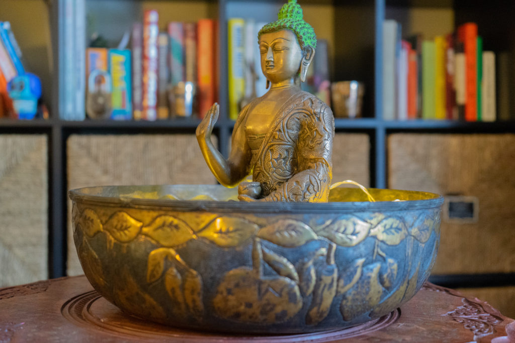 Affinity for antiques home tour of Rushika & Dipkal's - the brass buddha at the corner of the living room