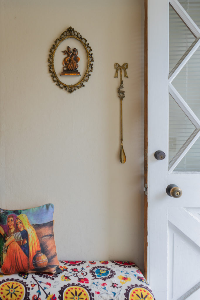 Affinity for antiques home tour of Rushika & Dipkal's - hanging frame at the corner of the room