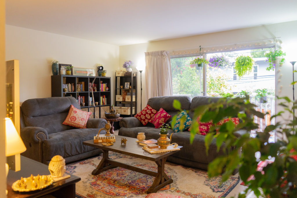 Affinity for antiques home tour of Rushika & Dipkal's - adding elements of color to living room in the form of fabric, art and general decor pieces