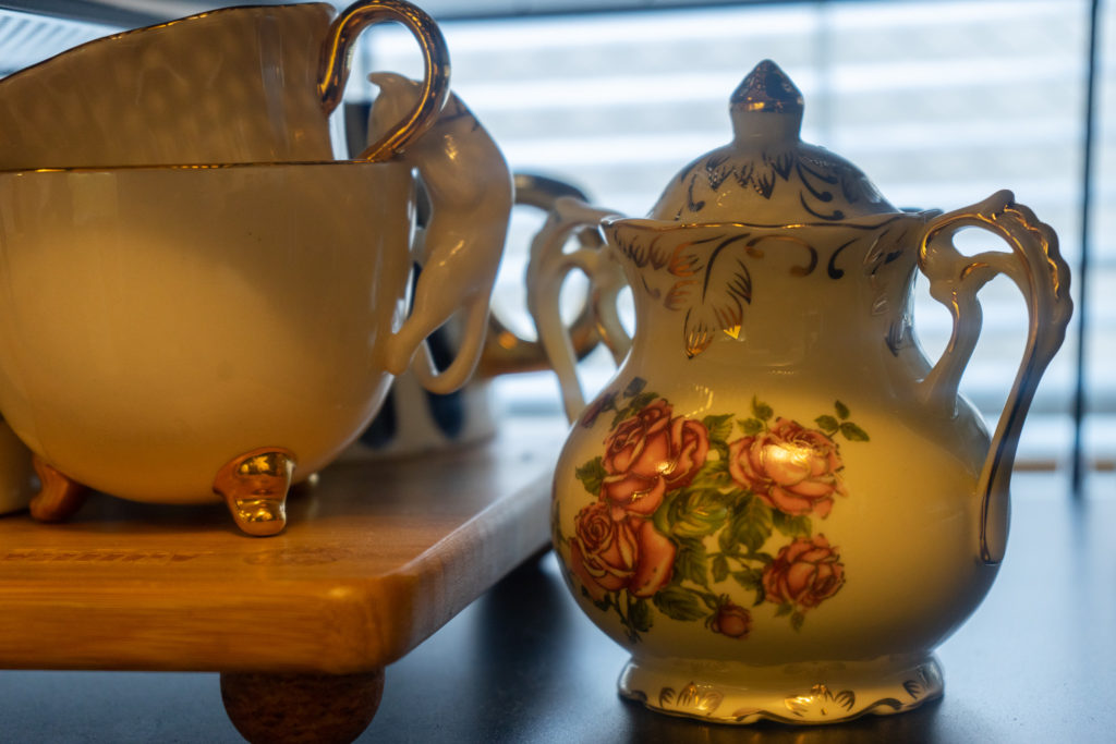 Affinity for antiques home tour of Rushika & Dipkal's - tea sets at the kitchen cabinet