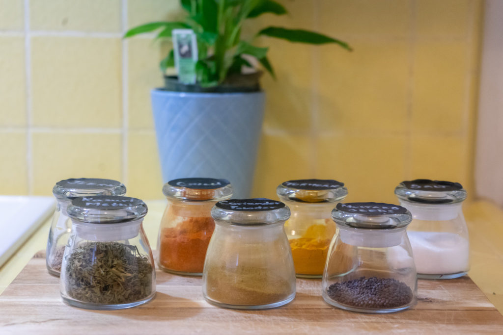 Affinity for antiques home tour of Rushika & Dipkal's - kitchen storage glass container