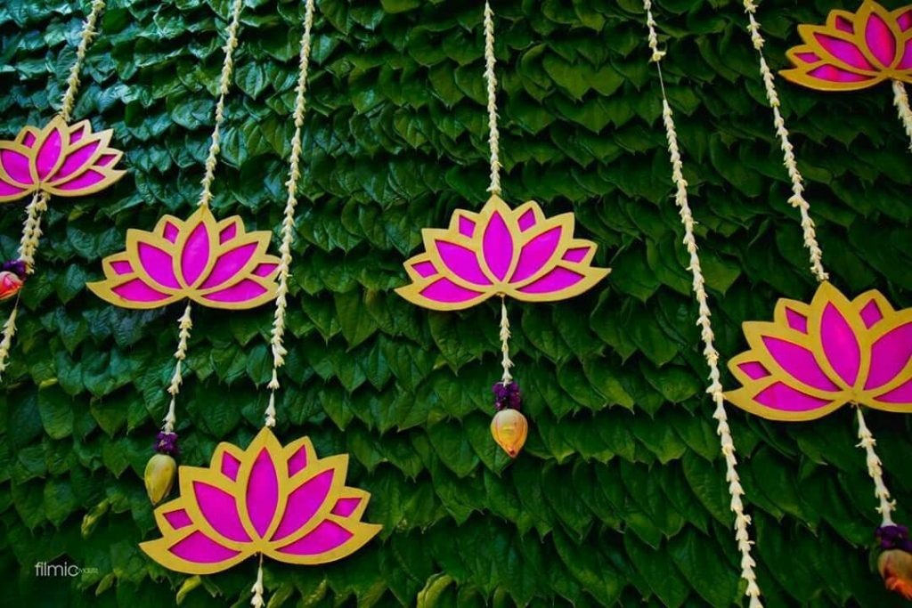 Covered the entire area of banana leaf with fresh betel leaves and mini roses were pinned randomly for some color
