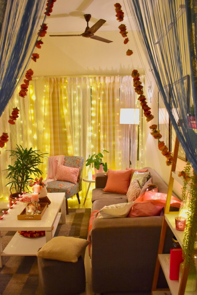 In this Diwali the living room is decorated with embracing Pink and Peach pastel pellet with a tinge of gold and silver
