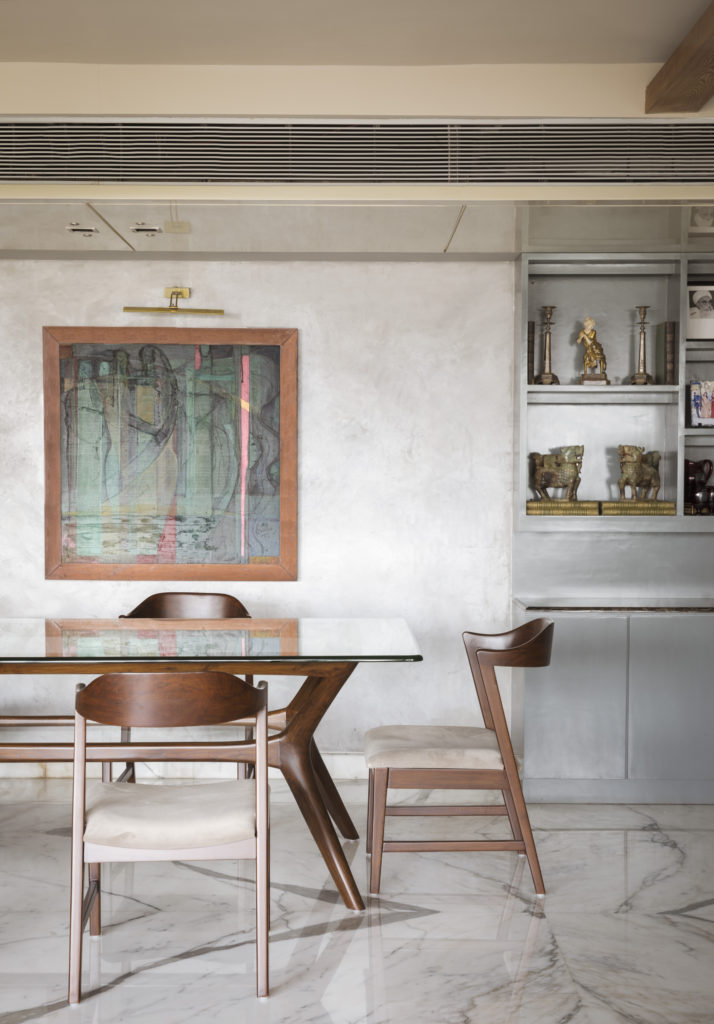 Home Renovation Story | Mohamedi & Durriya Sham's Aesthetic Mumbai Home - The dining table was used a mid-century design and a combination of Burma teak and glass.