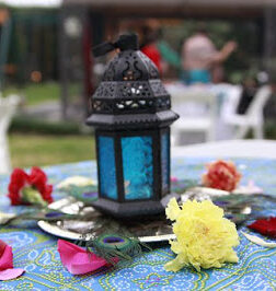 the perfect table setting of Peacock feathers, Flowers, Lanterns for diwali festival