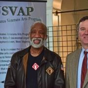 USVAP- 2 men and sign