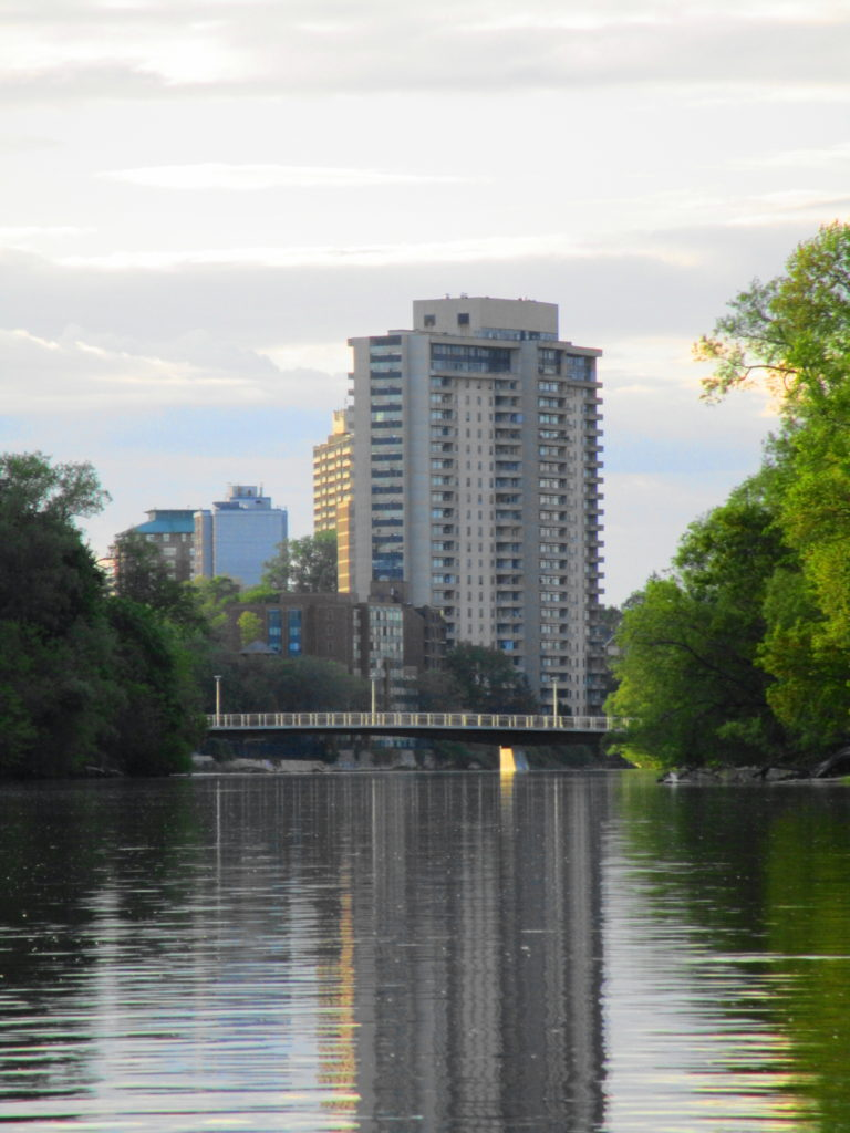 The evening sun casts its last rays on the Rideau River and the Adawe Crossing footbridge.