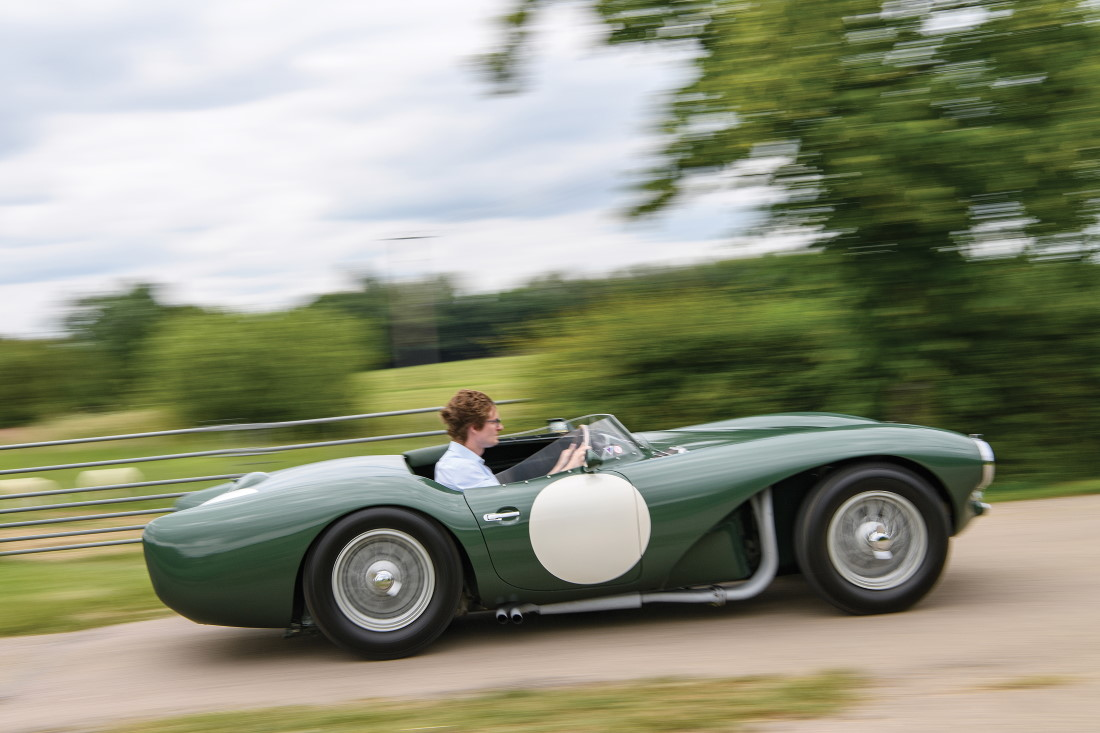 RM Sotheby's Car Specialist Michael Squire behind the wheel of the 1953 Aston Martin DB3S Works (Tim Scott © 2019 Courtesy of RM Sotheby's)