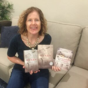 Katrina holding the Czech edition and the Polish Edition of Henry