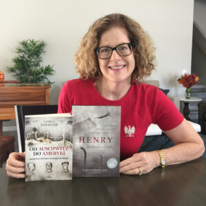 Katrina Shawver holding the Polish edition of HENRY: A Polish Swimmer's True Story of Friendship from Auschwitz to America