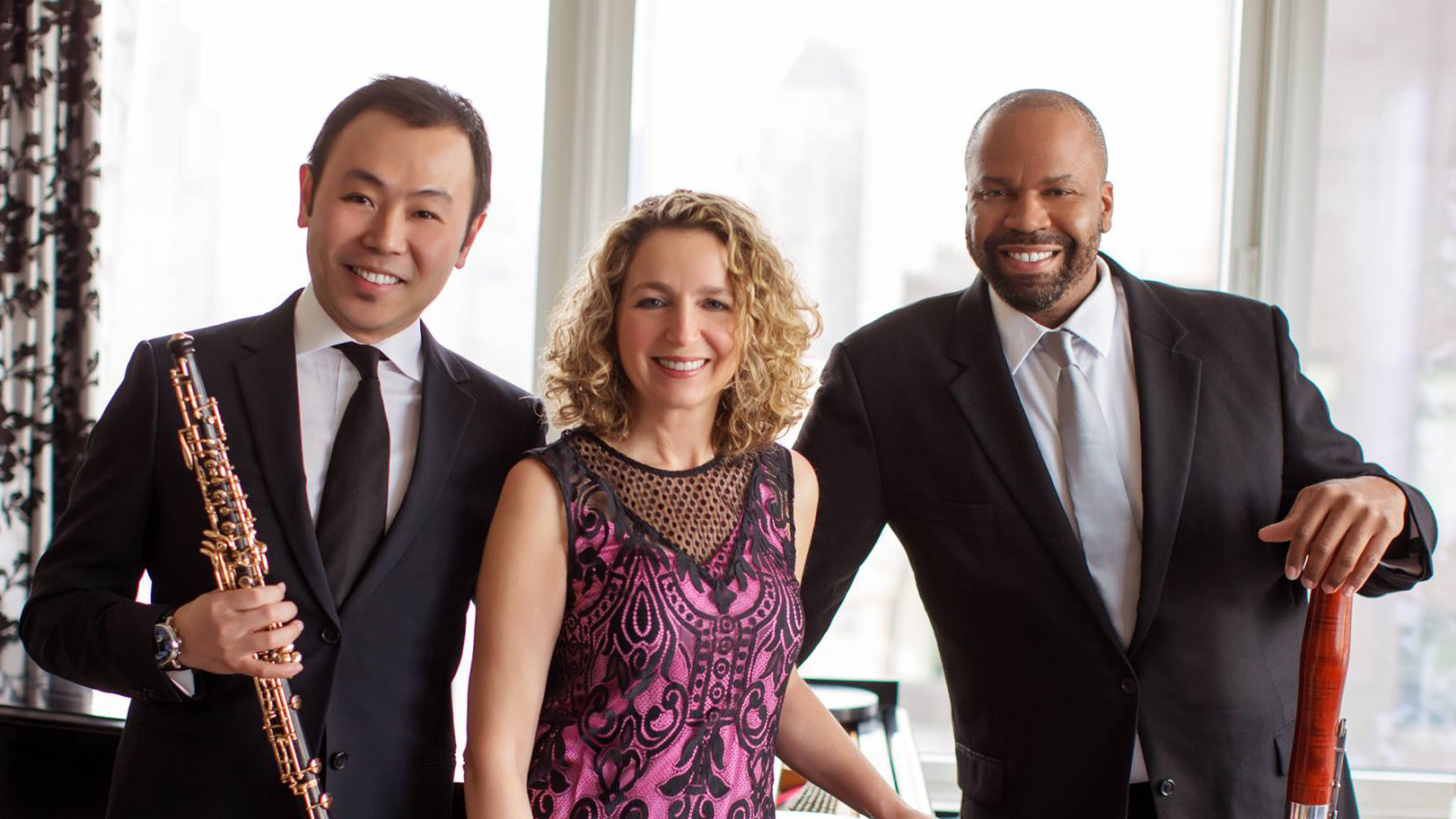 Bryan Young with Poulenc Trio Three people smiling