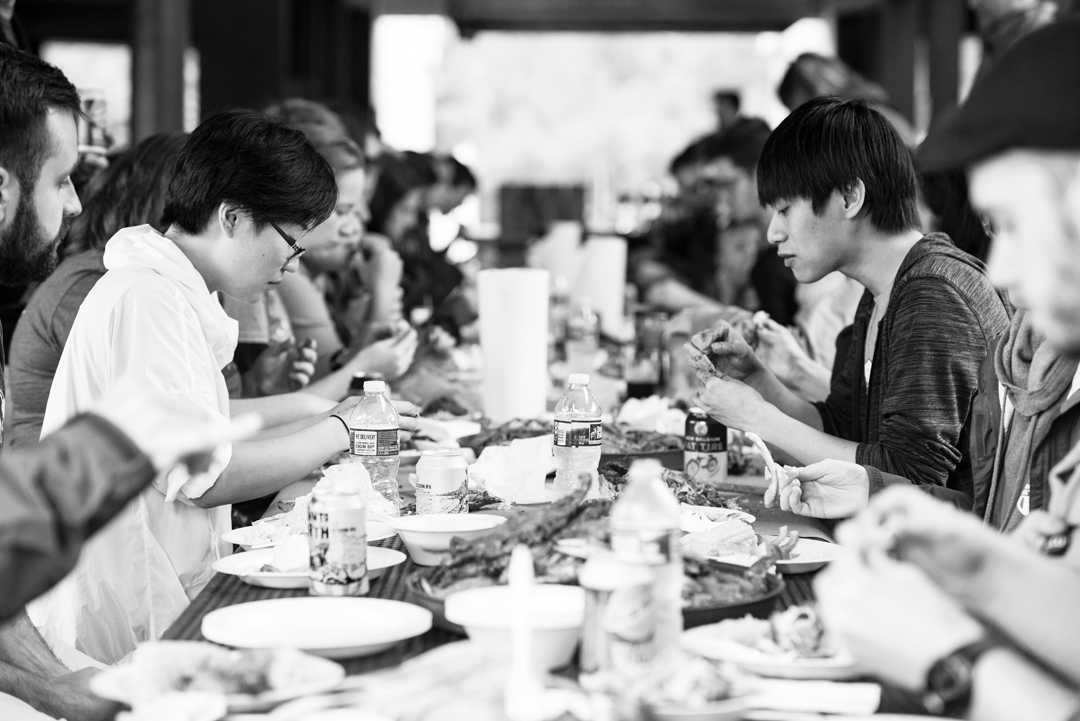 people sitting at table eating crabs crab feast