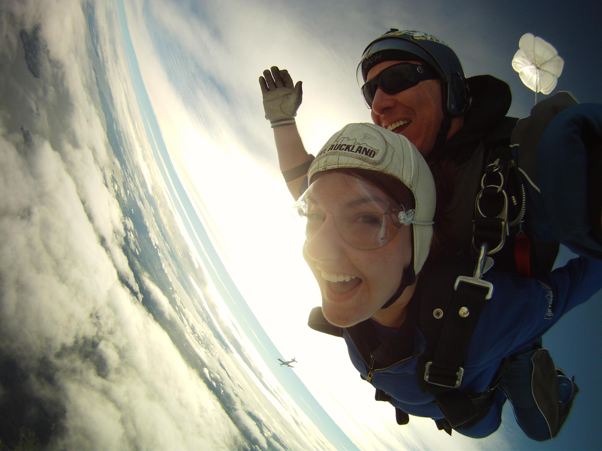 Woman skydiving tandem