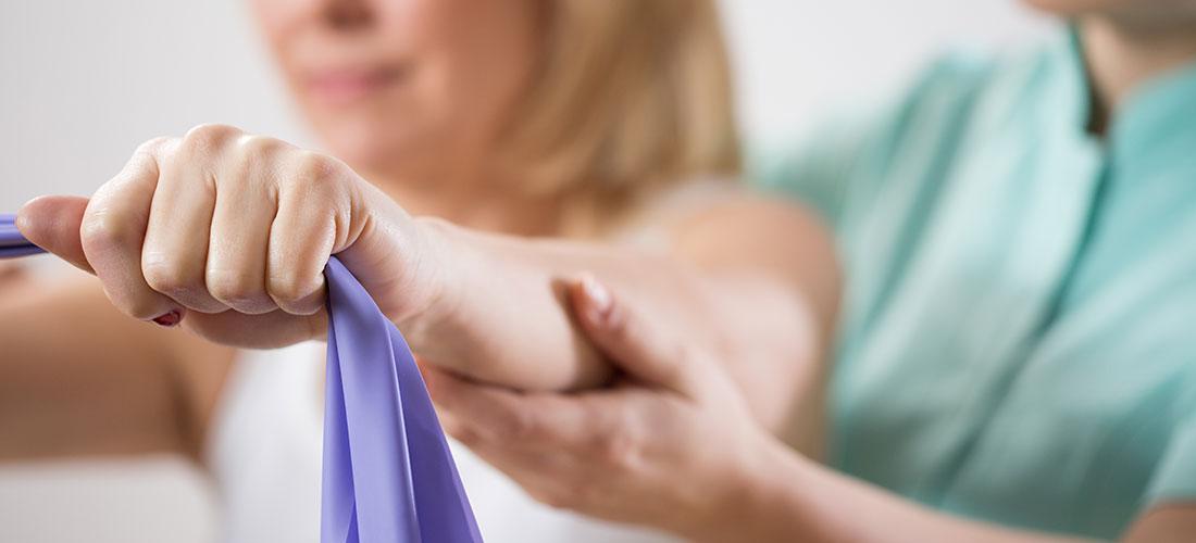 older women performing shoulder exercise