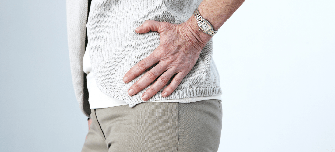 person holding hip