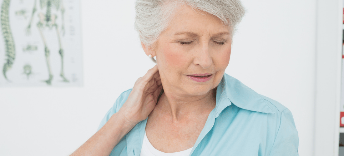 women holding neck in pain
