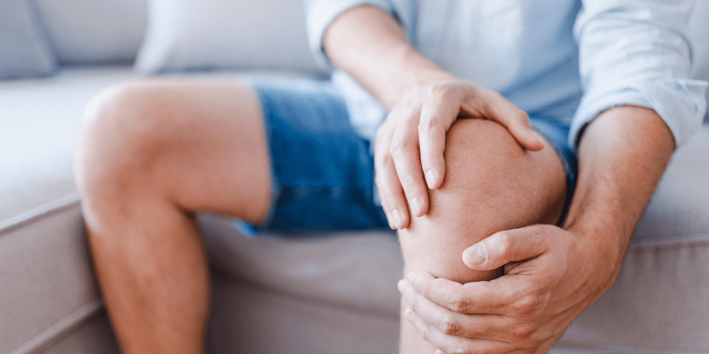 person holding knee