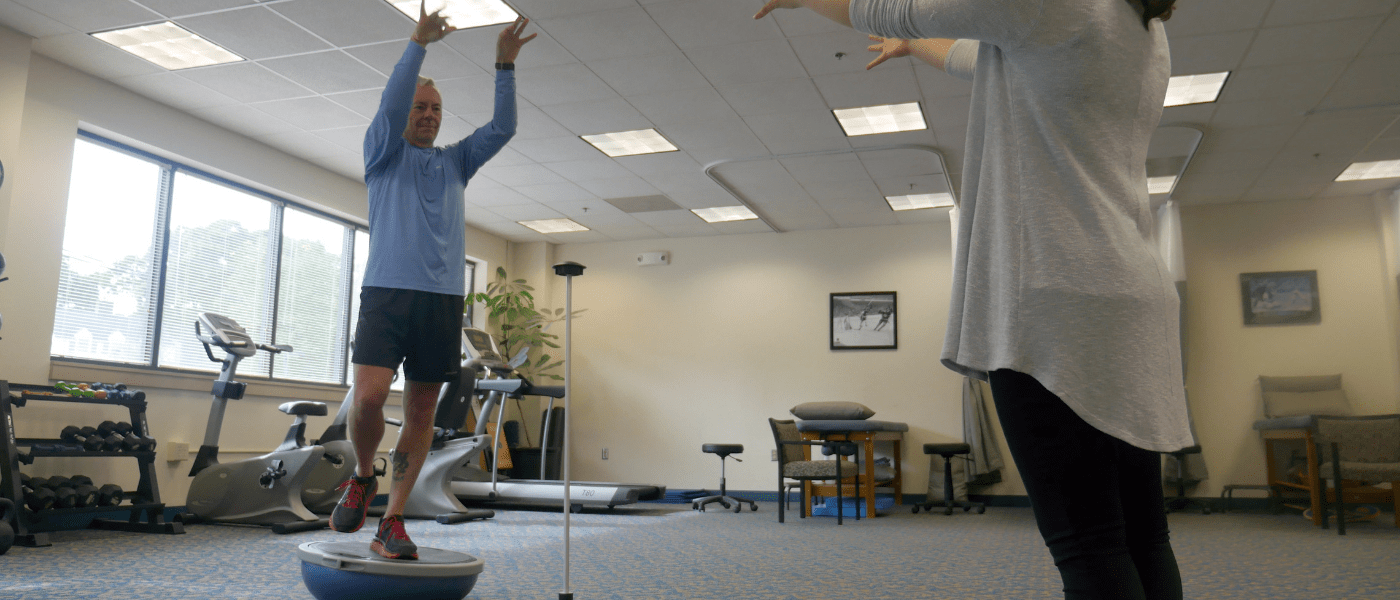 physical therapist working with stability ball