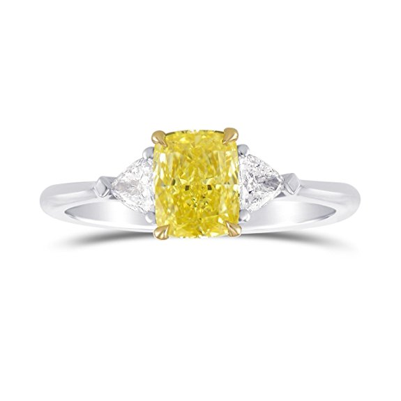 A beautiful 1.25 carats Fancy Intense Yellow Cushion diamond 3 Stone Ring Set in Platinum . It comes with an elegant gift box. Manufactured by Leibish and Co.