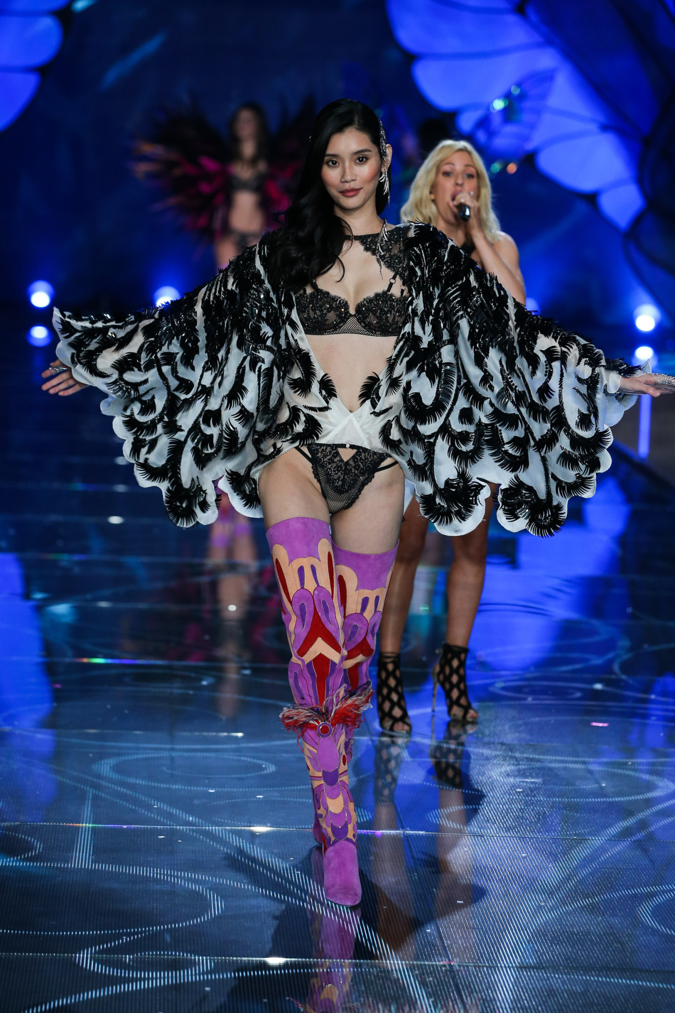 Model Ming Xi walks the runway at the 2015 Victoria's Secret Fashion Show in New York City on November 10th, 2015
