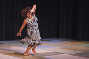 "Kimberly Savage-Dawkins performs her piece ""Overcoming"". Photography by Amanda Tipton."