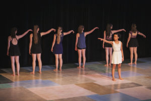 "Dancers perform ""Reaching Unity"" choreographed by Isabel Koontz. Photography by Amanda Tipton."