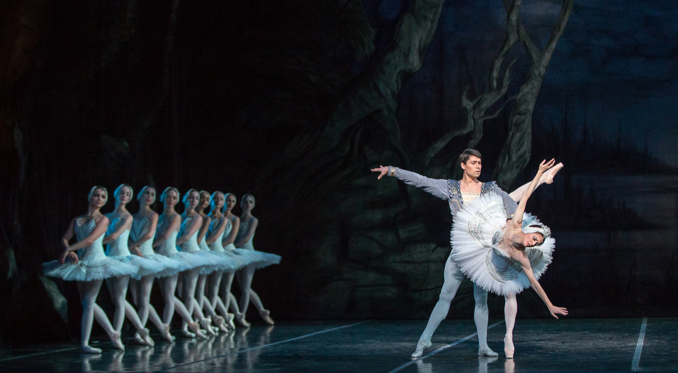 Maria Mosina and Alexei Tyukov and Artists of Colorado Ballet in Swan Lake. Photo by Mike Watson. Image courtesy of Colorado Ballet.